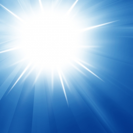 Intense sun on a soft blue background photo