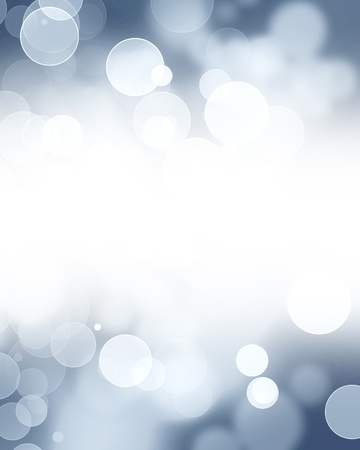 Silver glitters on a soft blurred background with smooth highlights photo