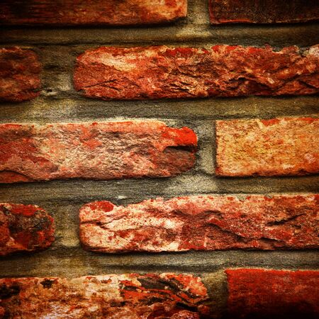 Grunge brick wall with some damage and cracks Stock Photo - 15009583