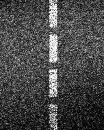 Asphalt texture with some shades and white line photo