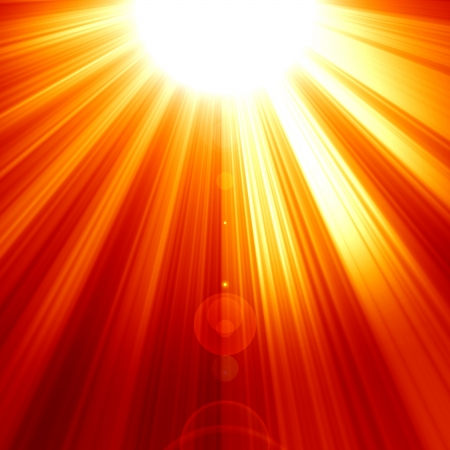 Red sun with an intense glow and sun beams photo