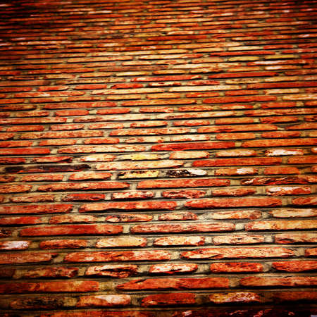 Grunge brick wall with some damage and cracks Stock Photo - 15612792