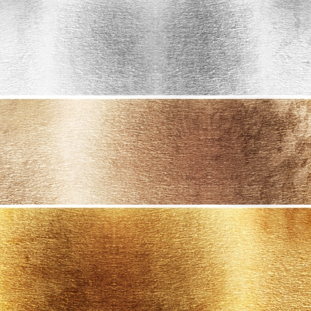 Aluminium, brass and golden plates with some reflected lights and reflections Stock Photo - 18103000
