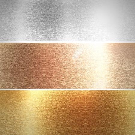 Aluminio, bronce y dorado placas con algunas luces reflejadas y reflexiones