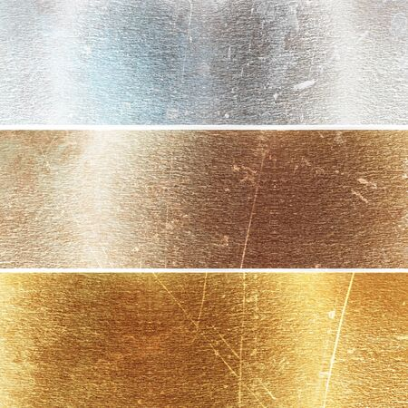 Aluminium, brass and golden plates with some reflected lights and reflections Stock Photo - 18102998
