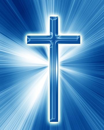 christelijk kruis op een zachte blauwe achtergrond Stockfoto