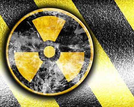 nuclear sign on a grunge background with yellow and black stripes Stock Photo - 21878144