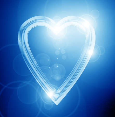 silver heart on a soft blue background Stock Photo - 21878294