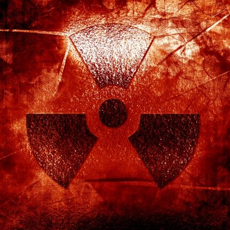 radioisotope: nuclear sign on an old rusty metal panel