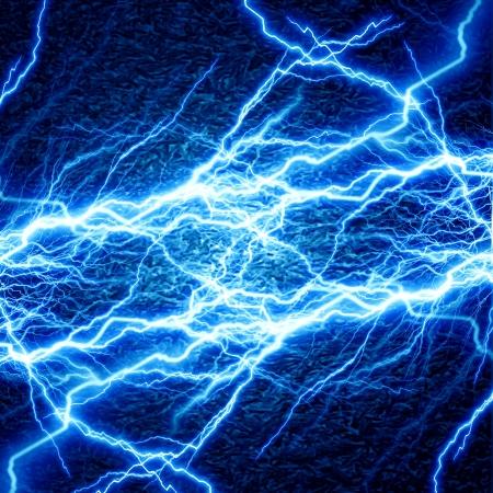 lightning strike: bright electrical spark on a dark blue background Stock Photo