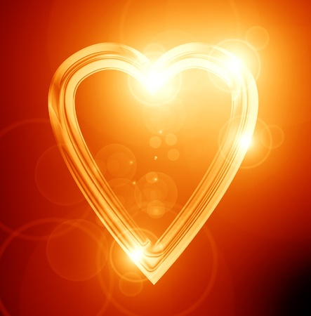 golden heart on a soft red background photo