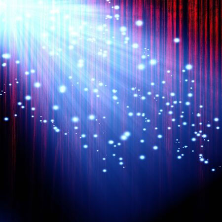 red movie or theater curtain with a bright spotlight with glitters and sparkles photo