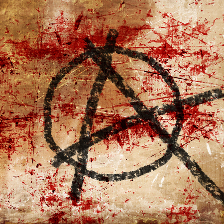 anarchy symbol on an old grunge wall background