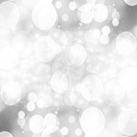 soft silver background with some blurred xmas lights on it photo
