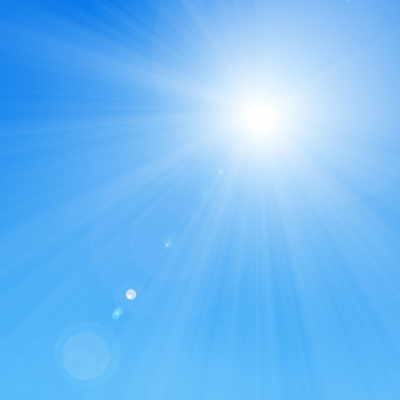 bright glowing summer sun on a soft blue background Stock Photo - 22347561