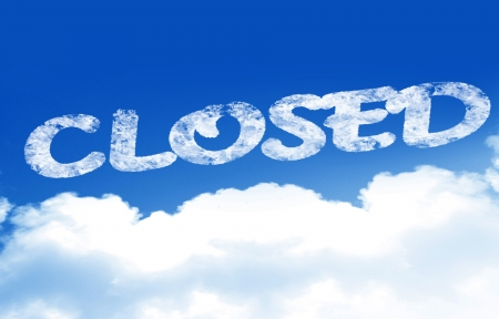 white clouds in a blue sky with the word closed photo