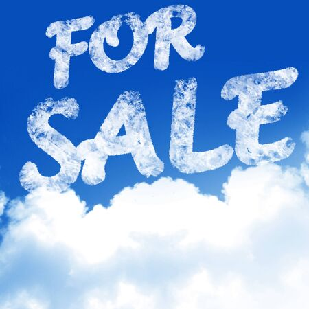 white clouds in a clear blue sky with (for) sale written in it photo