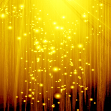 golden spotlight with some glitter and sparkles on it photo