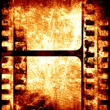 grunge brown filmstrip with some spots and stains on it photo