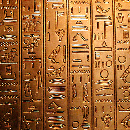 egyptian hieroglyphs on a shiny golden panel photo