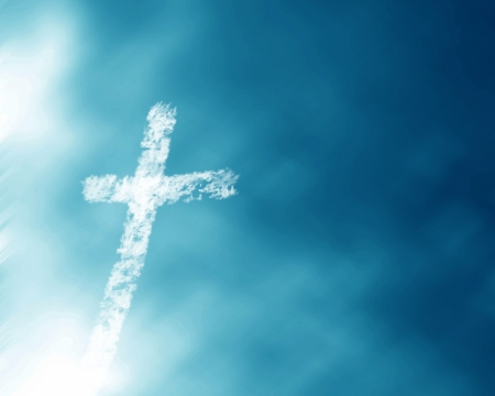 protestant: christian cross in a blue sky with some clouds