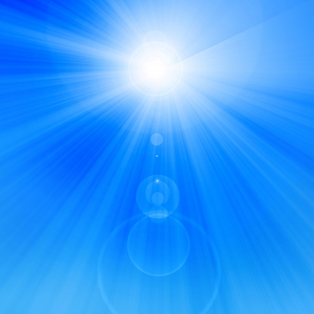 bright glowing summer sun on a soft blue background photo