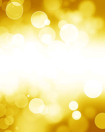 Golden glitters on a soft blurred background with smooth highlights