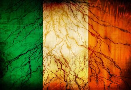 Irish flag waving in the wind with some spots and stains Reklamní fotografie