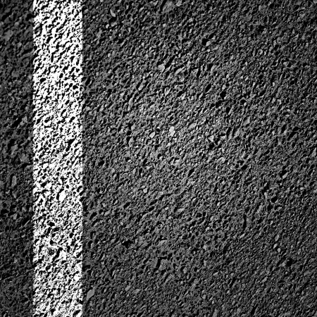 asphalt background texture with some fine grain in it photo