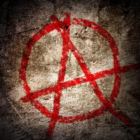 anarchy: anarchy symbol on an old grunge wall background