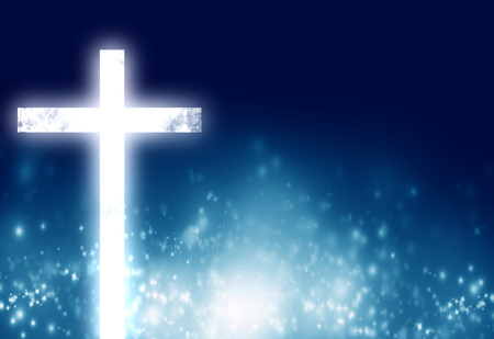 jesuit: glowing christian cross on a blue background with some glitters