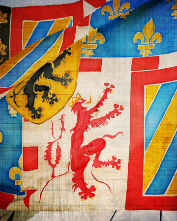 joust: colorful medieval escutcheon with some spots and stains on it Stock Photo