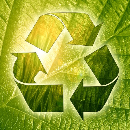recycle sign on a fresh green background photo