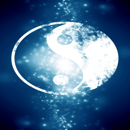 yin yang sign on a dark blue background photo