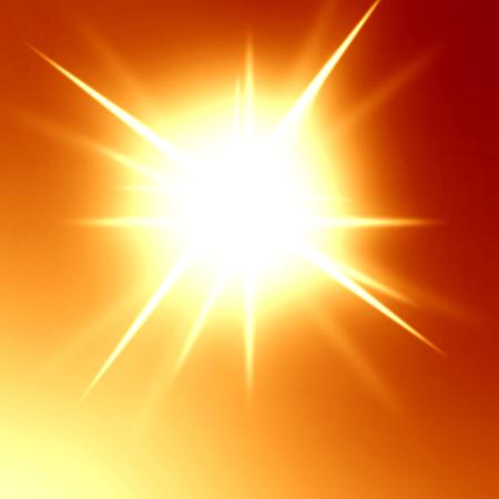 bright glowing summer sun in an orange sky photo