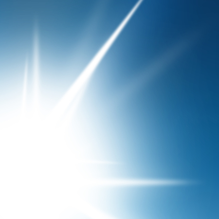 abstract glowing summer sun in a clear blue sky photo