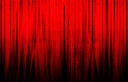 red movie or theater curtains with a bright spotlight on it photo