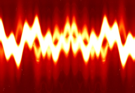 bright sound wave on a soft red background photo
