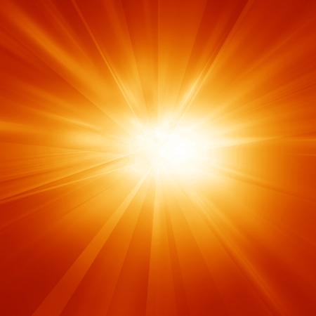 Bright summer sun on a orange and yellow background photo