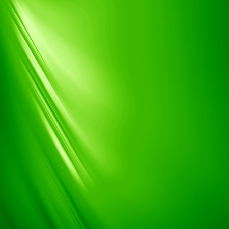 green satin or silk background with some smooth folds in it Stock Photo