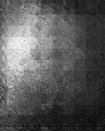 Worn metal plate with reflected light