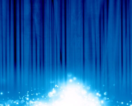 intense: Blue stage background with an intense blue spotlight