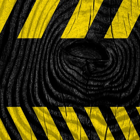 construction vehicle: Black and yellow hazard stripes with some soft highlights Stock Photo