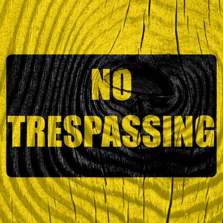 urban area: No trespassing sign with black and orange colors