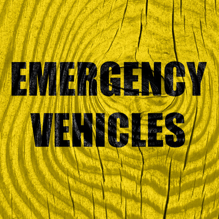 emergency lane: Emergency services sign with yellow and black colors