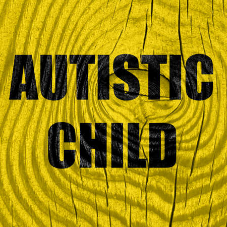 autistic: Autistic child sign with orange and black colors Stock Photo