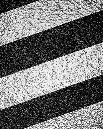 road paving: Asphalt background texture with some soft shades and spots