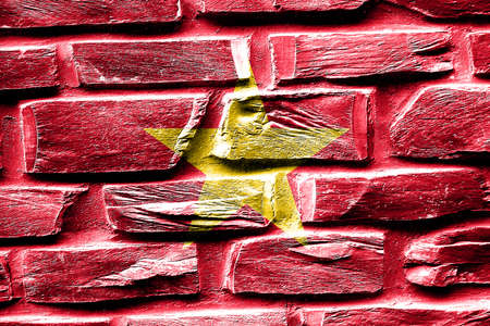 vietnam flag: Brick wall Vietnam flag with some cracks and vintage look Stock Photo