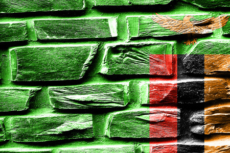 vintage look: Brick wall Zambia flag with some cracks and vintage look