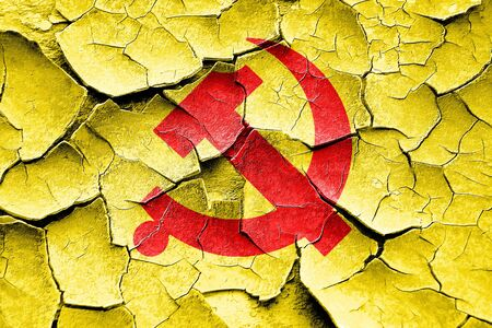 socialist: Grunge cracked Communist sign with red and yellow vivid colors Stock Photo
